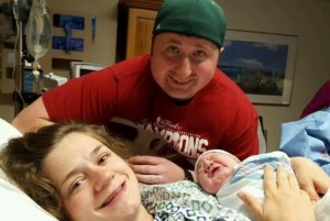 Lydia, Joel, and baby Lennon take their first photo as a family of 3.